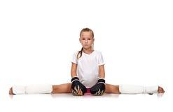 Menina que senta-se nas separações Imagem de Stock