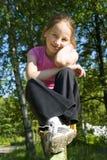 Menina que senta-se no balanço Fotos de Stock Royalty Free