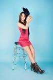 Menina que senta-se no barchair Foto de Stock Royalty Free