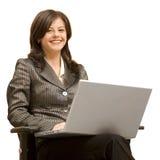 Menina que senta-se no computador Imagem de Stock
