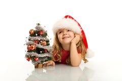 Menina que sonha sobre o Natal Foto de Stock Royalty Free