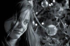 Menina que sorri no Natal Fotografia de Stock Royalty Free