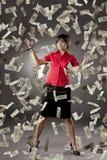 Menina que tem muito dinheiro imagem de stock