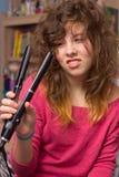 Menina que tem o dia ruim do cabelo imagens de stock royalty free