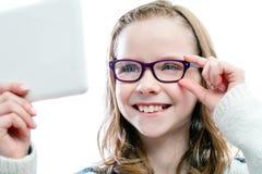 Menina que tenta vidros novos Fotografia de Stock Royalty Free