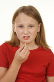 Menina que toma um comprimido Fotos de Stock Royalty Free
