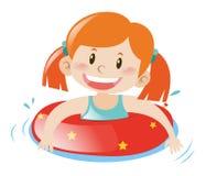 Menina que usa a borracha de flutuação Fotografia de Stock Royalty Free