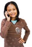 Menina que usa um telefone de pilha Imagens de Stock