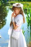 Menina que vai ao primeiro comunhão santamente Foto de Stock Royalty Free