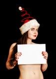 Menina que veste o chapéu espiral vermelho engraçado de Santa fotografia de stock royalty free