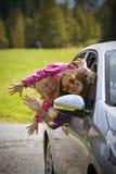 Menina que viaja em um carro Imagem de Stock Royalty Free