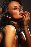 Menina quente no fundo escuro Fotografia de Stock