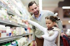 A menina quer o leite fotos de stock royalty free