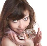 A menina realiza no frasco das mãos com perfume imagens de stock royalty free