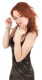 Menina red-haired bonita nas algemas Fotos de Stock