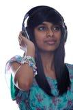 A menina relaxa à música Imagens de Stock