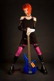 Menina romântica com guitarra baixa imagens de stock
