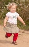 A menina running Imagens de Stock