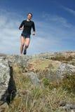 Menina Running nos shorts ao ar livre Fotos de Stock Royalty Free