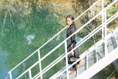 Menina séria no roupa de mergulho Fotografia de Stock