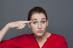 Menina 20s bonita para o conceito da dúvida e da confusão Foto de Stock