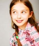 A menina salta em um fundo cinzento Imagens de Stock Royalty Free