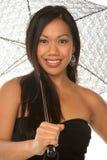 Menina Sassy sob o guarda-chuva fotos de stock royalty free