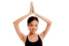 A menina saudável asiática bonita faz a pose da ioga Fotografia de Stock
