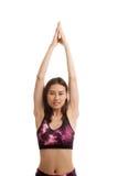 A menina saudável asiática bonita faz a pose da ioga Fotos de Stock