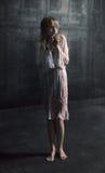 Menina scared nova sob a chuva Imagem de Stock Royalty Free