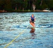 Menina Scared Wakeboarding imagem de stock