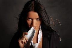 Menina sexual com um laço branco em um cinza Foto de Stock Royalty Free
