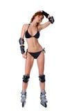 Menina 'sexy' bonita em patins de rolo. Imagem de Stock