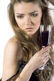 Menina 'sexy' bonita nova com um vidro do vinho vermelho Fotos de Stock Royalty Free