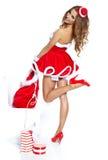Menina 'sexy' bonita que desgasta a roupa de Papai Noel Fotos de Stock Royalty Free