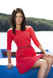 Menina 'sexy' bonito no vestido vermelho Imagem de Stock Royalty Free