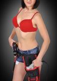 Menina 'sexy' com broca elétrica Fotografia de Stock Royalty Free