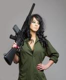 Menina 'sexy' com metralhadora Fotografia de Stock Royalty Free