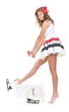 Menina 'sexy' do inverno nos patins e no vestido curto branco Imagem de Stock Royalty Free
