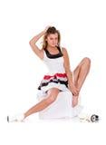 Menina 'sexy' do inverno nos patins e no vestido curto branco Imagem de Stock
