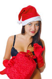 Menina 'sexy' na roupa interior preta e em um chapéu do Natal Fotografia de Stock