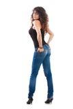 Menina 'sexy' nas calças de brim Fotografia de Stock