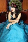 Menina 'sexy' no vestido azul fotografia de stock royalty free
