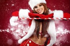 Menina 'sexy' que desgasta a roupa de Papai Noel foto de stock royalty free