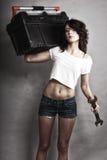Menina 'sexy' que guarda a chave inglesa da caixa de ferramentas e da chave Fotos de Stock Royalty Free