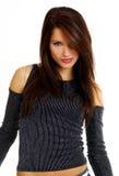 Menina 'sexy' quente do ajuste nas calças de brim Imagens de Stock