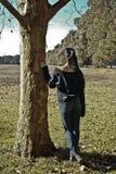 Menina sob a árvore Fotos de Stock Royalty Free