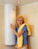 Menina sobre o calefator de água Fotografia de Stock Royalty Free