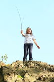 Menina sobre a rocha Imagens de Stock Royalty Free