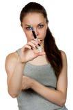 Menina sobre uma seringa à disposição Imagens de Stock